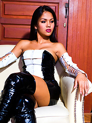 Ladyboy Amy shows her black boots and tight sexy dress
