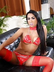 Exotic beauty Amy posing in sexy red stockings