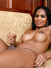 Golden-skinned asian shemale showing her perfect boobs