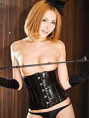 Sexy tgirl in black corset and boots strips and jerks