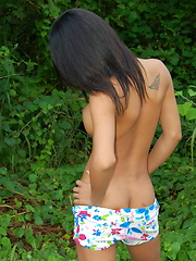 Pooy is a petite dickgirl who proudly shows her big boobies and her little dick outdoors