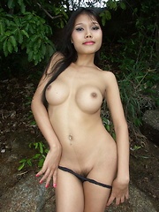 Hot Thai ladyboy proudly flashing her big boobs, her butthole and her dick outdoors