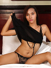 June is on all fours on her bed flashing close-ups of her dick and her hairy bumhole