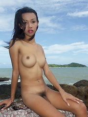 Hot and busty Thai ladyboy skinny dipping on a Phuket's beach