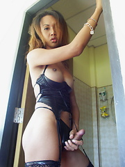 Pik is a busty Thai ladyboy who likes to play with her dick before taking a shower