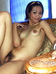 Asian shemale proudly posing nude in her house
