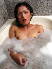 Petite shemale playing with her boner while taking a foam bath