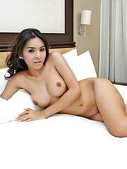Ladyboy lays back and jerks her cock