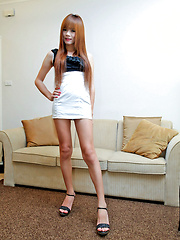 Fiery redheaded Asian tranny wanks and cums