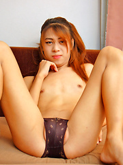 Pretty young Asian ladyboy wanks her cock