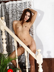 Exotic hottie plays on the stairs