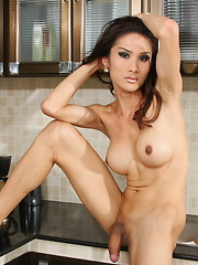 TS Tina strips & plays in the kitchen