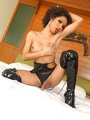 Ladyboy Odette wearing black leather boots