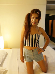 21 year old Thai ladyboy stripps and teases white cock